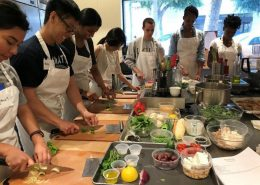 Students prepare a meal at the teaching kitchen.